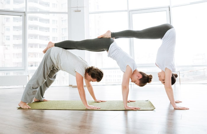 three person downward dog